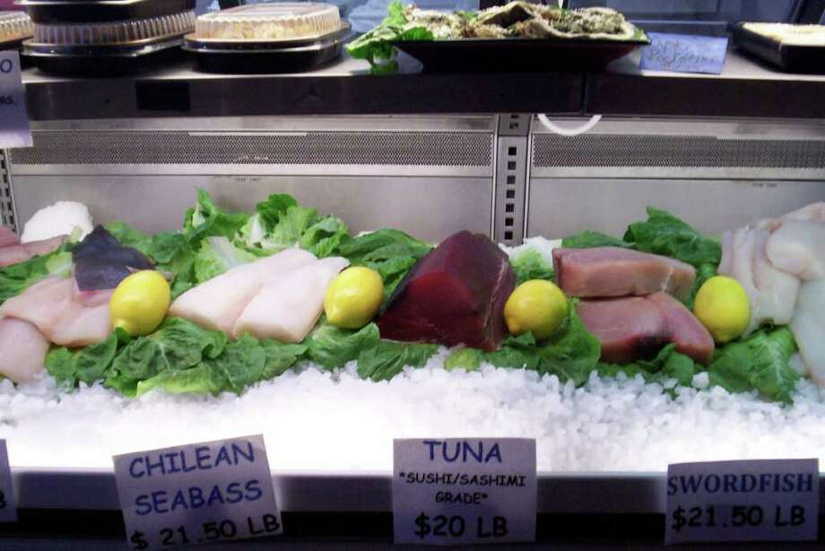 A variety of fresh fish is on sale at Vino & Mare in the Brick Walk in Fairfield, including sushi-grade tuna. Photo: Contributed Photo/Patti Woods / Fairfield Citizen contributed