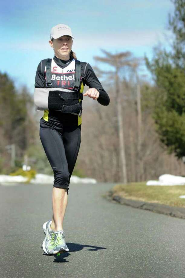 Robin Caruso of Ridgefield is a triathlete. The mother of three was hit by a car and lost the use of her right arm. Photo taken Wednesday, March 2, 2011. Photo: Carol Kaliff / The News-Times
