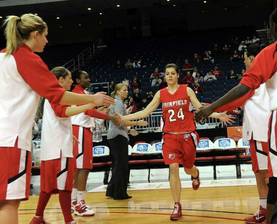 Fairfield's Joelle Nawrocki is greeted on the court before Friday's MAAC Tournament quarterfinal game at Webster Bank Arena at Harbor Yard on March 4, 2011. Photo: Lindsay Niegelberg / Connecticut Post