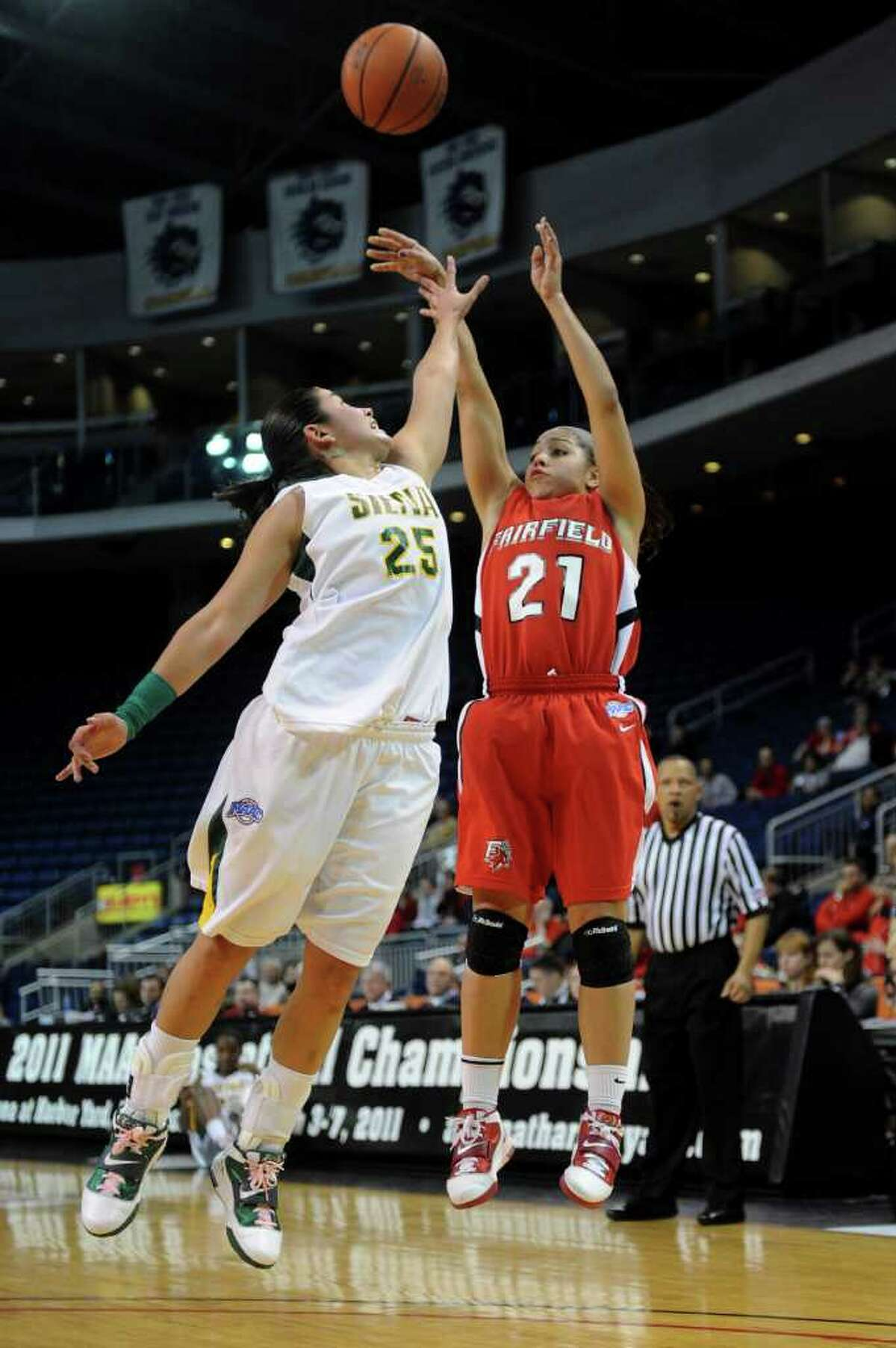 Fairfield's Desiree Pina takes a shot as Siena's Cristina Centeno defends during Friday's MAAC Tournament quarterfinal game at Webster Bank Arena at Harbor Yard on March 4, 2011.