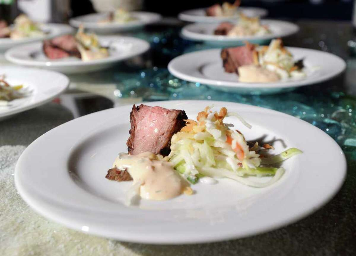 Flank Steak with Coconut Coleslaw and Jamaican Herb Dip by Fjord Catering of Stamford on display during the 26th annual Great Chefs at Hyatt Regency Greenwich, Friday night, March 4, 2011.