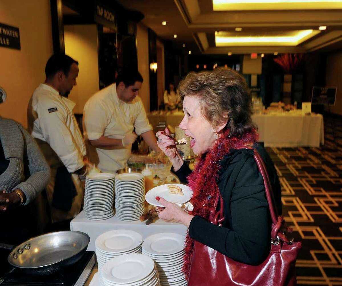 Monica Polikoff of Forest Hills, N.Y., samples the Lobster roll by the Crab Shell Seafood Restaurant of Stamford during the 26th annual Great Chefs at Hyatt Regency Greenwich, Friday night, March 4, 2011.