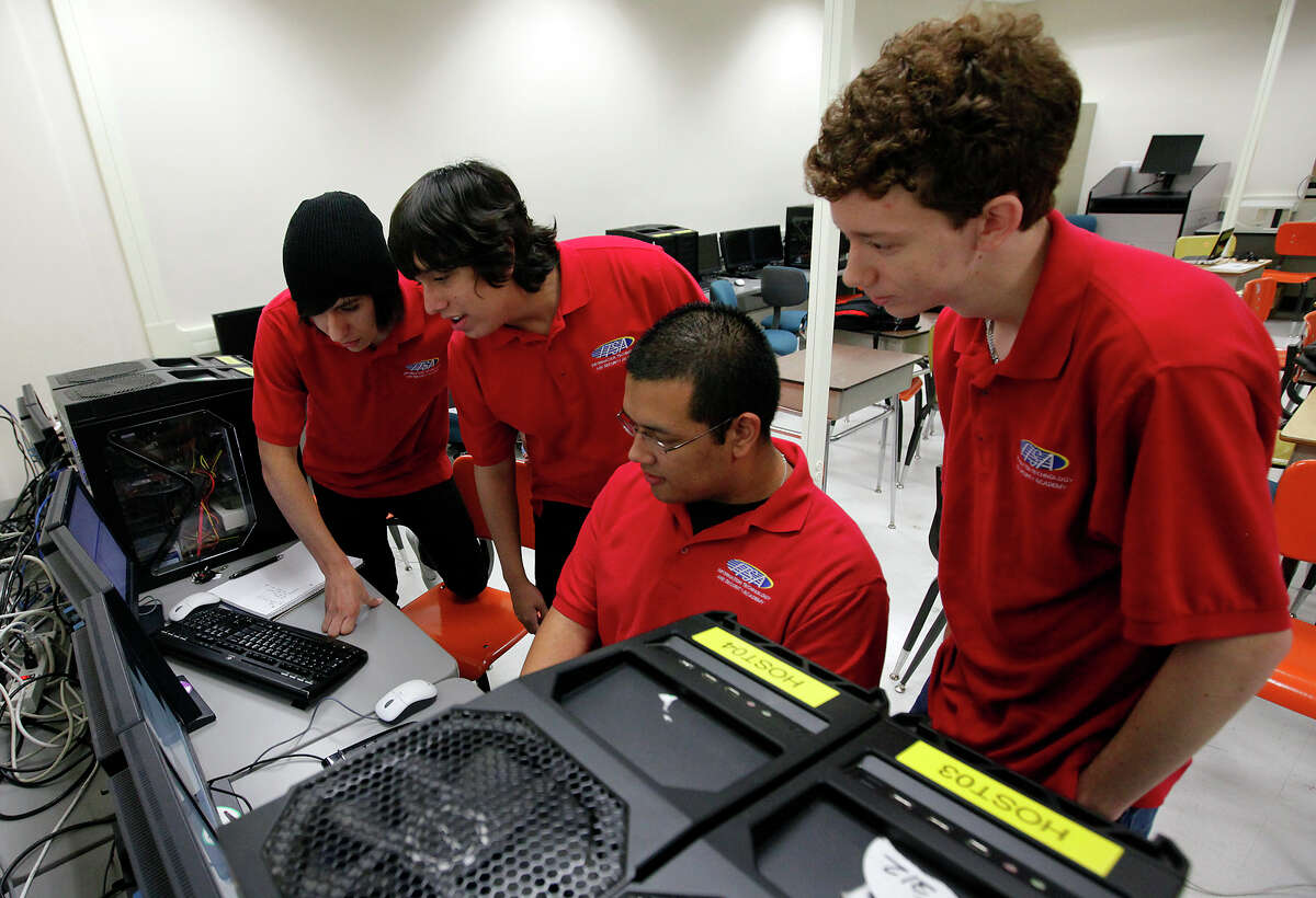 Area high school students Mario Puente (from left), Robert Flores, Clint Sierra and Tommy Roberts look at raw data on a terminal in a computer class at San Antonio College last week as they prepare for the CyberPatriot III competition.