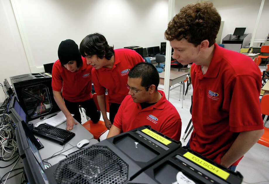 Area high school students Mario Puente (from left), Robert Flores, Clint Sierra and Tommy Roberts look at raw data on a terminal in a computer class at San Antonio College last week as they prepare for the CyberPatriot III competition. Photo: Kin Man Hui/kmhui@express-news.net / San Antonio Express-News