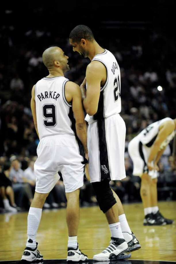 San Antonio Spurs guard Tony Parker of France, left, shares a laugh with forward Tim Duncan before tipoff of their game with the Miami Heat in an NBA basketball game at the AT&T Center in San Antonio, Friday, March 4, 2011. Parker played in his first game back after a calf contusion. Photo: AP