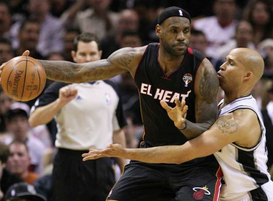 FOR SPORTS - Miami Heat forward LeBron James (6) is guarded by San Antonio Spurs forward Richard Jefferson (24) during first half action Friday March 4, 2011 at the AT&T Center. (PHOTO BY EDWARD A. ORNELAS/eaornelas@express-news.net) Photo: EDWARD A. ORNELAS, SAN ANTONIO EXPRESS-NEWS / San Antonio Express-News NFS