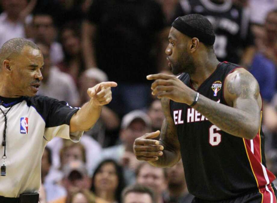 FOR SPORTS - Miami Heat forward LeBron James (6) disputes an offensive foul call with with referee Dan Crawford during first half action Friday March 4, 2011 at the AT&T Center. (PHOTO BY EDWARD A. ORNELAS/eaornelas@express-news.net) Photo: EDWARD A. ORNELAS, SAN ANTONIO EXPRESS-NEWS / San Antonio Express-News NFS
