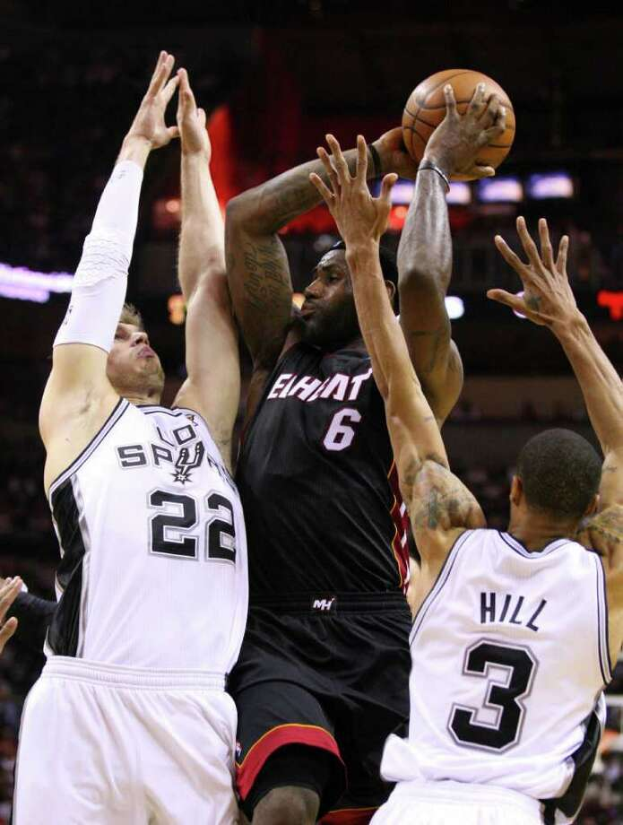 FOR SPORTS - Miami Heat forward LeBron James (6) is guarded by San Antonio Spurs forward Tiago Splitter (22) and San Antonio Spurs guard George Hill (3) during second half action Friday March 4, 2011 at the AT&T Center. (PHOTO BY EDWARD A. ORNELAS/eaornelas@express-news.net) Photo: EDWARD A. ORNELAS, SAN ANTONIO EXPRESS-NEWS / San Antonio Express-News NFS