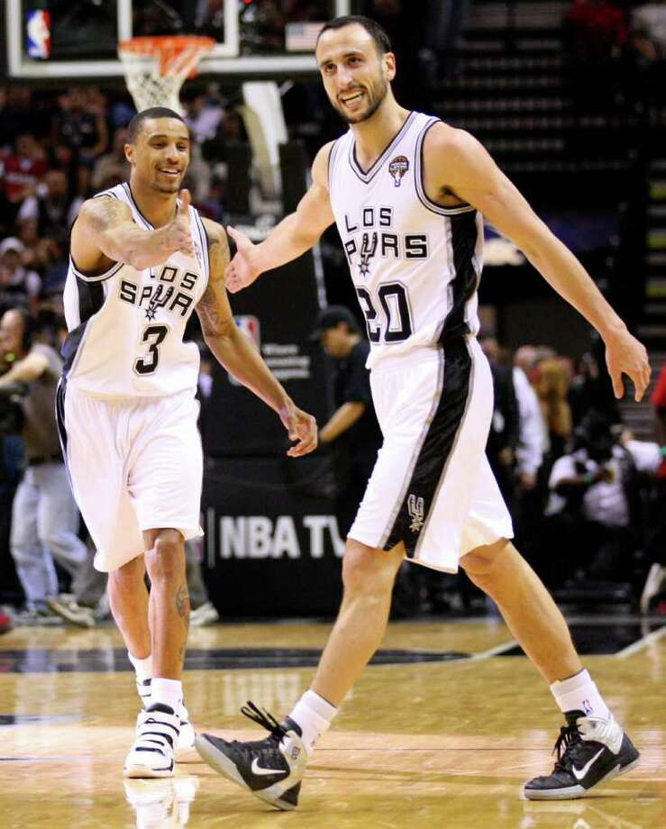 FOR SPORTS - San Antonio Spurs guard Manu Ginobili (20) reacts near San Antonio Spurs guard George Hill (3) during second half action Friday March 4, 2011 at the AT&T Center. (PHOTO BY EDWARD A. ORNELAS/eaornelas@express-news.net) Photo: EDWARD A. ORNELAS, SAN ANTONIO EXPRESS-NEWS / San Antonio Express-News NFS