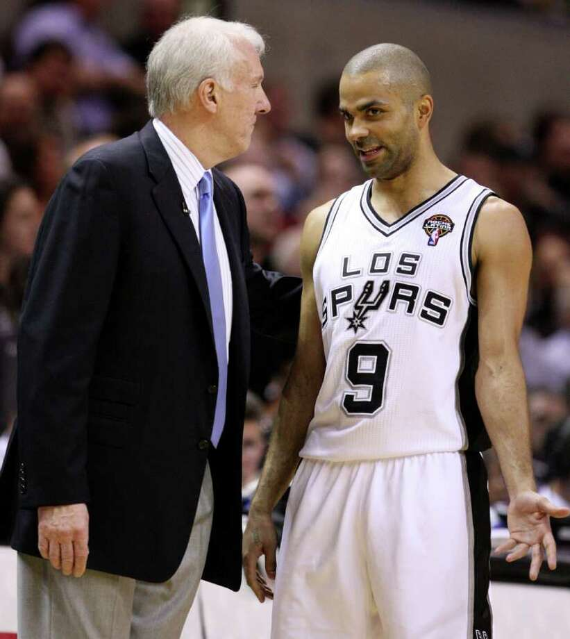FOR SPORTS - San Antonio Spurs guard Tony Parker (9) talks to San Antonio Spurs head coach Gregg Popovich during second half action Friday March 4, 2011 at the AT&T Center. (PHOTO BY EDWARD A. ORNELAS/eaornelas@express-news.net) Photo: EDWARD A. ORNELAS, SAN ANTONIO EXPRESS-NEWS / San Antonio Express-News NFS