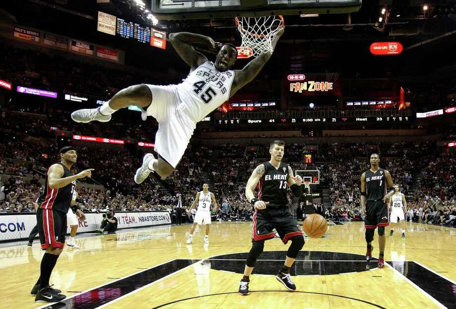 Spurs' DeJuan Blair (45) slams home two-points against the Miami Heat at the AT&T Center on Friday, Mar. 4, 2011. Spurs defeated the Heat, 125-95. Kin Man Hui/kmhui@express-news.net Photo: KIN MAN HUI, SAN ANTONIO EXPRESS-NEWS / San Antonio Express-News NFS