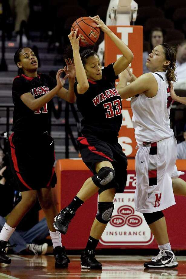 UIL GIRLS BASKETBALL STATE CHAMPIONSHIPS...Wagner guard Arielle Roberson (33) brings down a rebound as Irving MacArthur's Karmyn Jackson, right, watches during  action in the game between San Antonio Wagner and Irving MacArthur 5A semi-final round at the Erwin Center in Austin Friday, March 04, 2011......Photo by Larry Kolvoord...AUSTIN AMERICAN-STATESMAN Photo: Larry Kolvoord