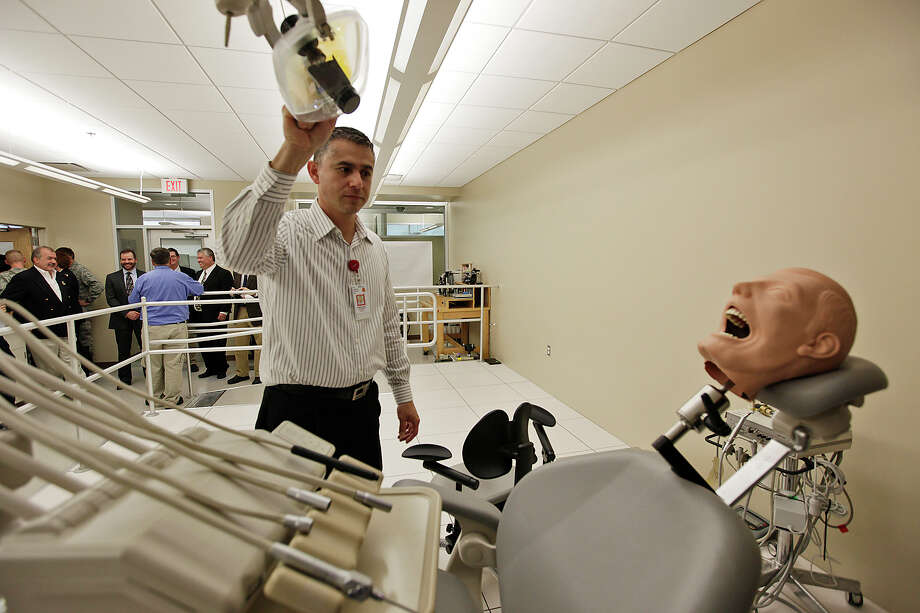 Biomedical equipment technician Anthony Marroquin turns on a light in a dental equipment laboratory at the Battlefield Health and Trauma Research Institute. Photo: Jerry Lara/glara@express-news.net / SAN ANTONIO EXPRESS-NEWS
