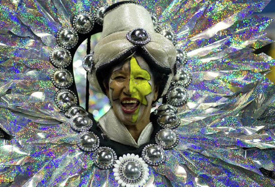 A dancer performs during the parade of Rosas de Ouro samba school in Sao Paulo, Brazil, Saturday, March 5, 2011. Brazil's official carnival is held this year March 4-8. (AP Photo/Andre Penner) Photo: Andre Penner, ASSOCIATED PRESS / Associated Press