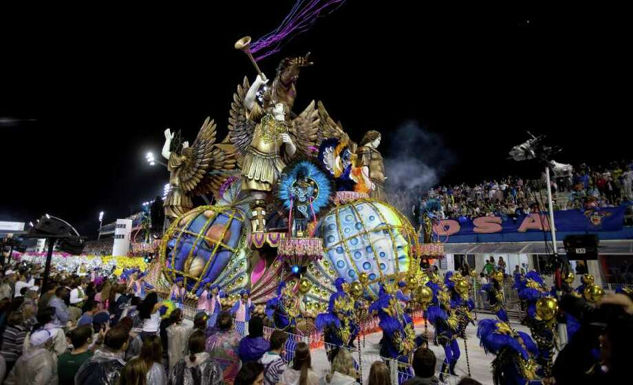 Dancers perform on a float during the parade of Rosas de Ouro samba school in Sao Paulo, Brazil, Saturday, March 5, 2011. Brazil's official carnival is held this year March 4-8. (AP Photo/Andre Penner) Photo: Andre Penner, ASSOCIATED PRESS / Associated Press