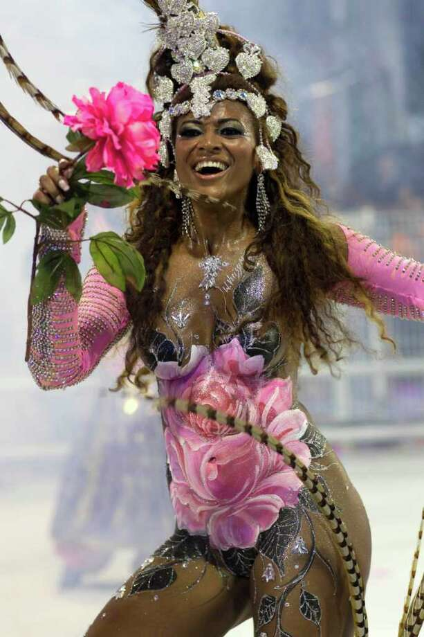 **  EDS NOTE NUDITY  ** A dancer performs during the parade of Rosas de Ouro samba school in Sao Paulo, Brazil, Saturday, March 5, 2011. Brazil's official carnival is held this year March 4-8. (AP Photo/Andre Penner) Photo: Andre Penner, ASSOCIATED PRESS / Associated Press