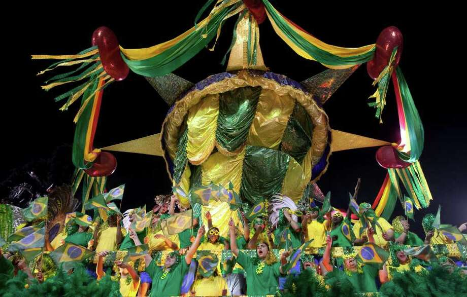 Dancers perform on a float during the parade of Academicos do Tucuruvi samba school in Sao Paulo, Brazil, Saturday, March 5, 2011. Brazil's official carnival is held this year March 4-8. (AP Photo/Andre Penner) Photo: Andre Penner, ASSOCIATED PRESS / Associated Press