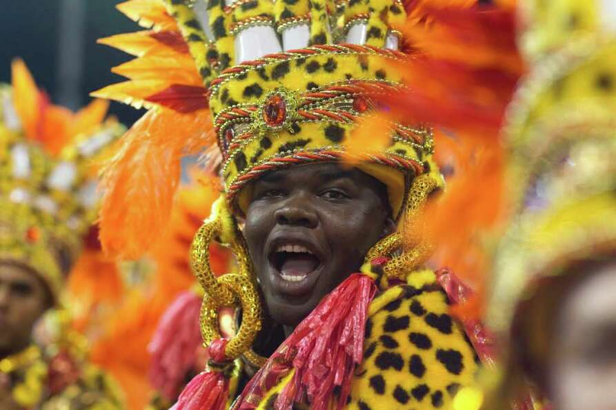 A drummer performs during the parade of Academicos do Tucuruvi samba school in Sao Paulo, Brazil, Sa
