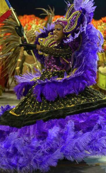 A dancer performs during the parade of Academicos do Tucuruvi samba school in Sao Paulo, Brazil, Sat