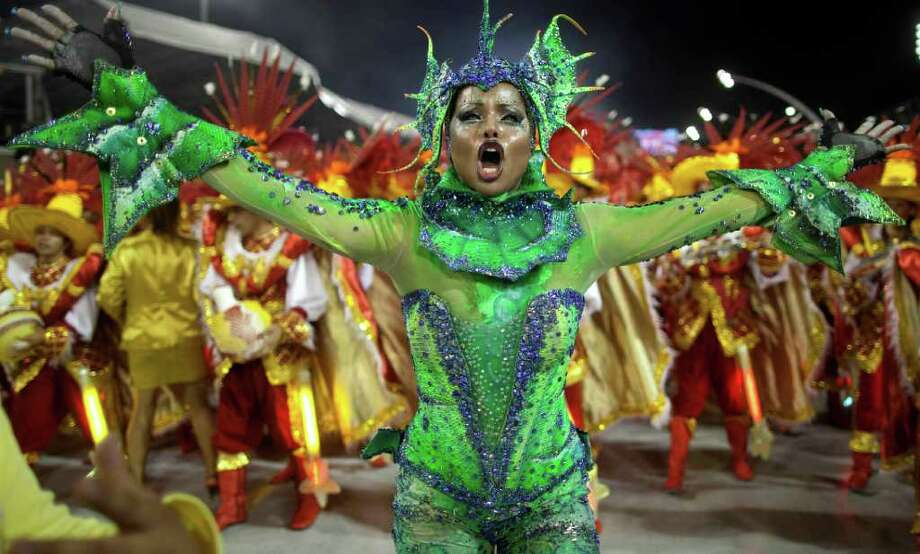 A dancer performs during the parade of Tom Maior samba school in Sao Paulo, Brazil, Saturday, March 5, 2011. Brazil's official carnival is held this year March 4-8. (AP Photo/Andre Penner) Photo: Andre Penner, ASSOCIATED PRESS / Associated Press