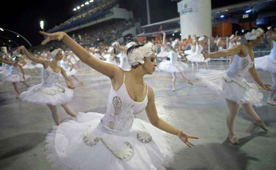Dancers perform during the parade of Unidos do Peruche samba school in Sao Paulo, Brazil, Friday, Ma