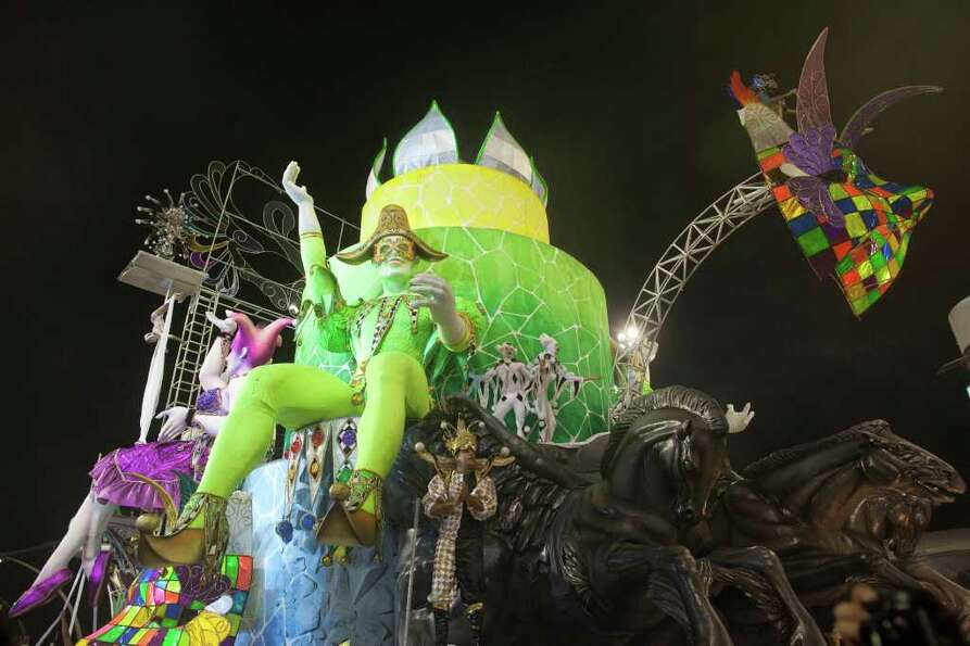 Dancers perform on a float during the parade of Unidos do Peruche samba school in Sao Paulo, Brazil,