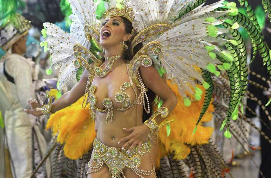 A dancer performs during the parade of Unidos do Peruche samba school in Sao Paulo, Brazil, Friday, March 4, 2011. Brazil's official carnival is held this year March 4-8. (AP Photo/Andre Penner) Photo: Andre Penner, ASSOCIATED PRESS / Associated Press