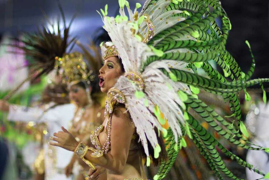 A dancer performs during the parade of Unidos do Peruche samba school in Sao Paulo, Brazil, Friday,