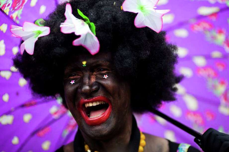 "A reveler sings during a ""Ceu na Terra"" street parade in Rio de Janeiro, Brazil, Saturday, March 5, 2011. The five-day annual carnival celebration officially started Friday and is expected to draw about 756,000 visitors, both foreign and Brazilian, who will pack hotels to nearly 100 percent capacity and spend about $559 million, according to Rio state's tourism department. (AP Photo/Felipe Dana) Photo: Felipe Dana, AP / Associated Press"