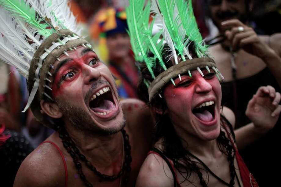 "Revelers sing during a ""Ceu na Terra"" street parade in Rio de Janeiro, Brazil, Saturday, March 5, 2011. The five-day annual carnival celebration officially started Friday and is expected to draw about 756,000 visitors, both foreign and Brazilian, who will pack hotels to nearly 100 percent capacity and spend about $559 million, according to Rio state's tourism department. (AP Photo/Felipe Dana) Photo: Felipe Dana, AP / Associated Press"