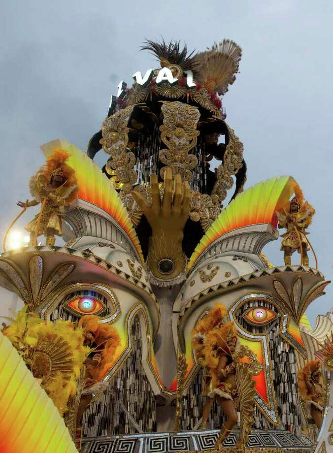 Dancers perform on a float during the parade of the Vai Vai samba school in Sao Paulo, Brazil, Saturday, March 5, 2011. Brazil's official carnival is held this year March 4-8. (AP Photo/Andre Penner) Photo: Andre Penner, ASSOCIATED PRESS / Associated Press