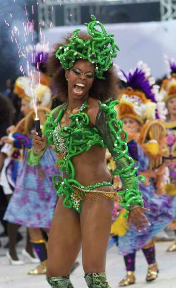 A dancer performs during the parade of the Vai Vai samba school in Sao Paulo, Brazil, Saturday, Marc
