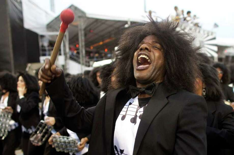 A drummer performs during the parade of the Vai Vai samba school in Sao Paulo, Brazil, Saturday, March 5, 2011. Brazil's official carnival is held this year March 4-8. (AP Photo/Andre Penner) Photo: Andre Penner, ASSOCIATED PRESS / Associated Press