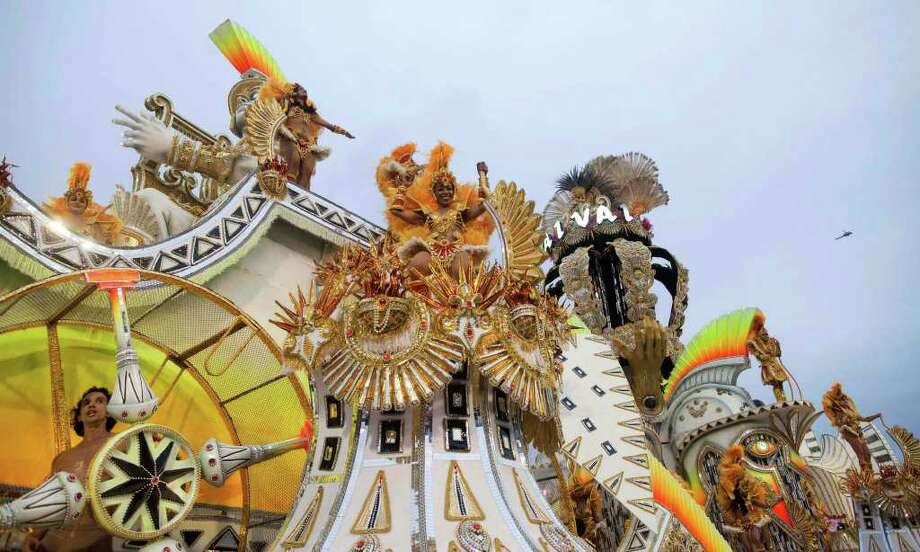 Dancers perform on a float during the parade of the Vai Vai samba school in Sao Paulo, Brazil, Saturday, March 5, 2011. Brazil's official carnival is held this year March 4-8. (AP Photo/Andre Penner) Photo: Andre Penner, AP / Associated Press