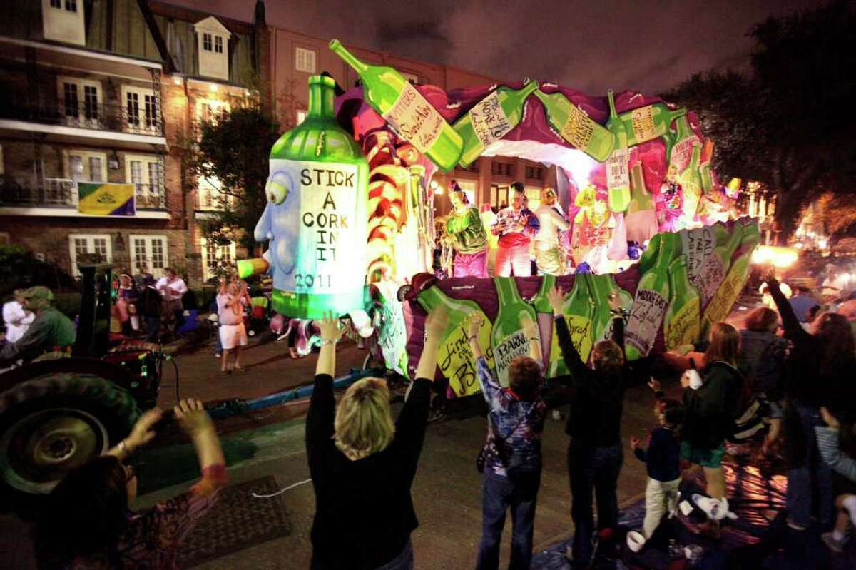 In this March 3, 2011 photo, the Krewe of Chaos Mardi Gras parade rolls down St. Charles Ave. in New Orleans. Along the French Gulf Coast, huge crowds are expected as Carnival rolls into high gear this weekend building toward Fat Tuesday, March 8. New Orleans expects its largest crowd since Hurricane Katrina struck in 2005. (AP Photo/Gerald Herbert)