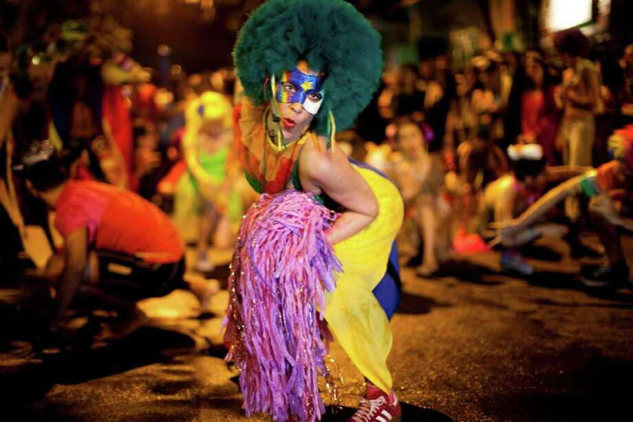 A reveler performs during the 'Mameludicos Euforicos' street carnival parade in Rio de Janeiro, Brazil, Thursday, March 3, 2011. (AP Photo/Rodrigo Abd) Photo: Rodrigo Abd, ASSOCIATED PRESS / Associated Press