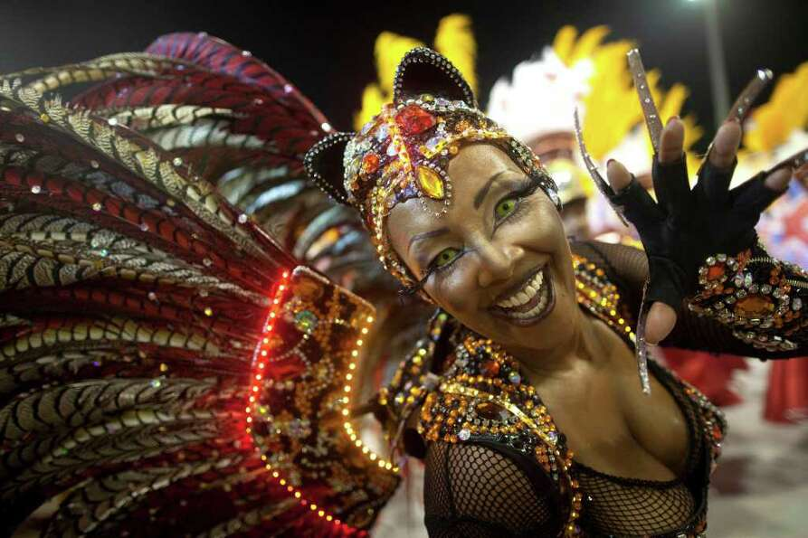A dancer performs during the parade of Tom Maior samba school in Sao Paulo, Brazil, Saturday, March