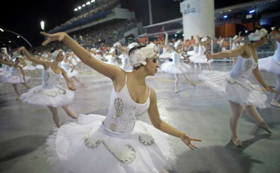 Dancers perform during the parade of Unidos do Peruche samba school in Sao Paulo, Brazil, Friday, March 4, 2011. Brazil's official carnival is held this year March 4-8. (AP Photo/Andre Penner) Photo: Andre Penner, ASSOCIATED PRESS / Associated Press