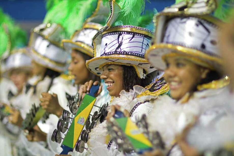 Drummers perform during the parade of Unidos do Peruche samba school in Sao Paulo, Brazil, Friday, March 4, 2011. Brazil's official carnival is held this year March 4-8. (AP Photo/Andre Penner) Photo: Andre Penner, ASSOCIATED PRESS / Associated Press