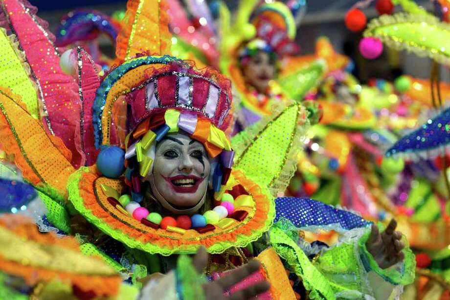 A dancer performs during the Unidos do Peruche samba school parade in Sao Paulo, Brazil, Friday, March 4, 2011. Brazil's official carnival is held this year March 4-8. (AP Photo/Andre Penner) Photo: Andre Penner, ASSOCIATED PRESS / Associated Press