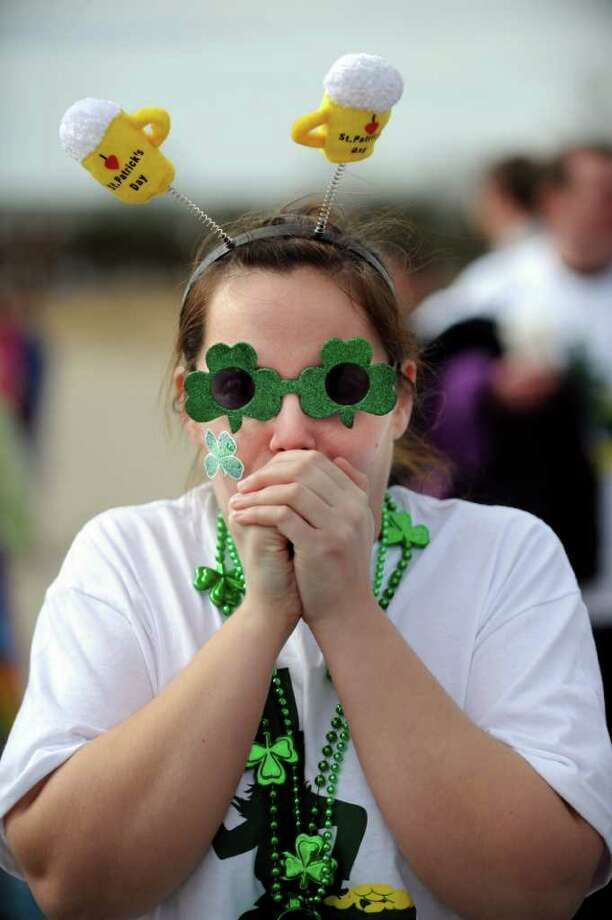 Jeanette Call, of Milford, gets ready to take the plunge Saturday, March 5, 2011 during the Milford Literacy Center's annual Leprechaun Leap at Walnut Beach in Milford, Conn. Photo: Autumn Driscoll / Connecticut Post