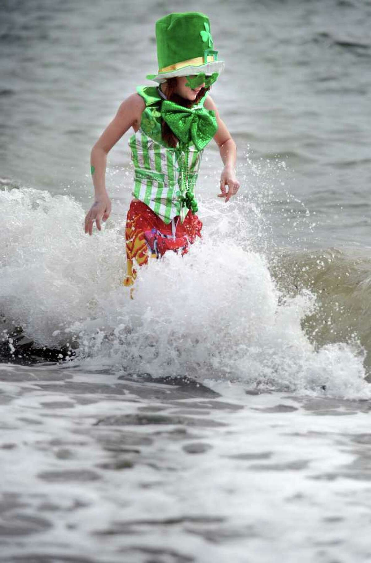 """Eleven-year-old Roger Bernard sticks it out in the chilly water off Walnut Beach Saturday, March 5, 2011 during the Milford Literacy Center's annual Leprechaun Leap. Bernard was the last """"leaper"""" out of the water."""