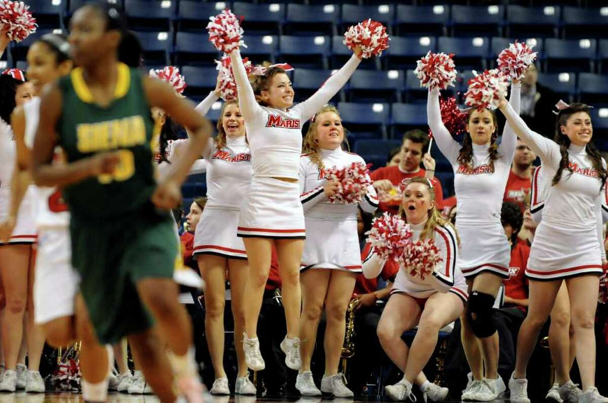 Marist cheerleaders celebrate a basket during their basketball game against Siena at the MAAC Championships on Saturday, March 5, 2011, at Webster Band Arena at Harbor Yard in Bridgeport, Conn. (Cindy Schultz / Times Union)