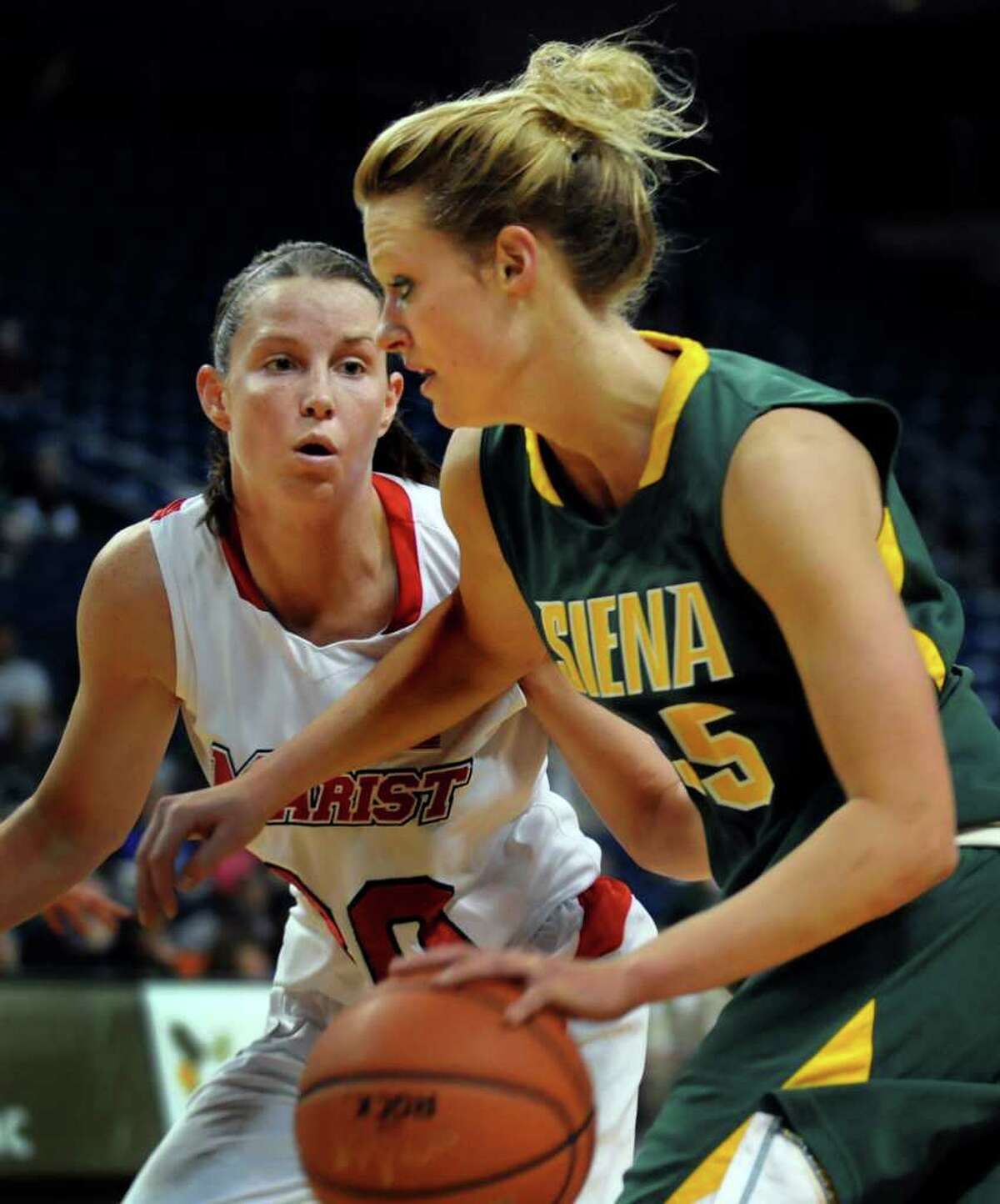 Siena's Maja Gerlyng (35), right, controls the ball as Marist's Erica Allenspach (30) defends during their basketball game at the MAAC Championships on Saturday, March 5, 2011, at Webster Band Arena at Harbor Yard in Bridgeport, Conn. (Cindy Schultz / Times Union)