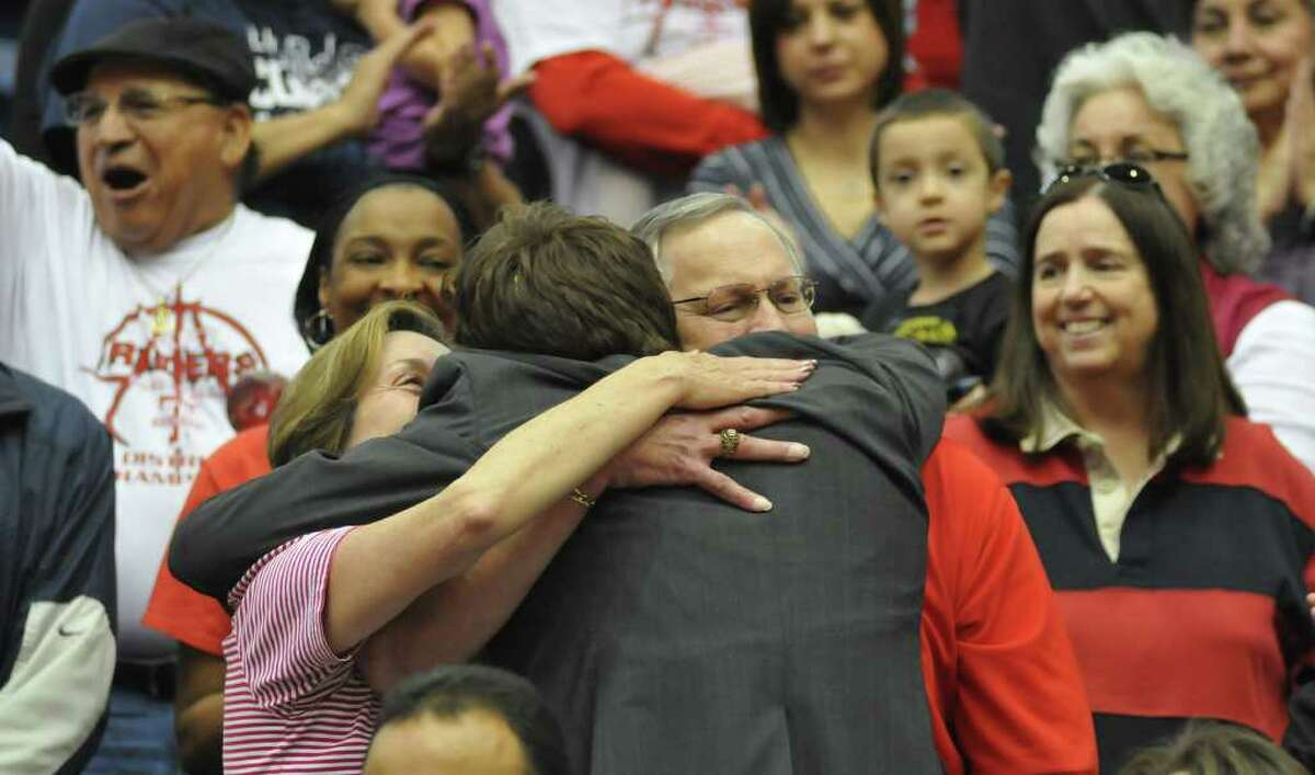 SLUG: BKB/Region IV-5A championship-Photo Request 52970-March 5, 2011--- Taft coach Joey Tate hugs his parents, Jodie and Ron Tate, following Taft's 46-40 vicoty over MacArthur 3/5. Photo by Robin Jerstad/Special to the Express-News
