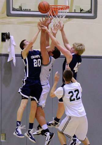 Boerne Champion's Chris Ormiston (20) and Brandon Bartos (40) battle for a rebound during the 4A boys regional championship basketball game between the Boerne Champion Chargers and the Cedar Park Timberwolves in Littleton Gym in San Antonio, Texas on March 5, 2011  John Albright / Special to the Express-News. Photo: JOHN ALBRIGHT, San Antonio Express-News / San Antonio Express-News