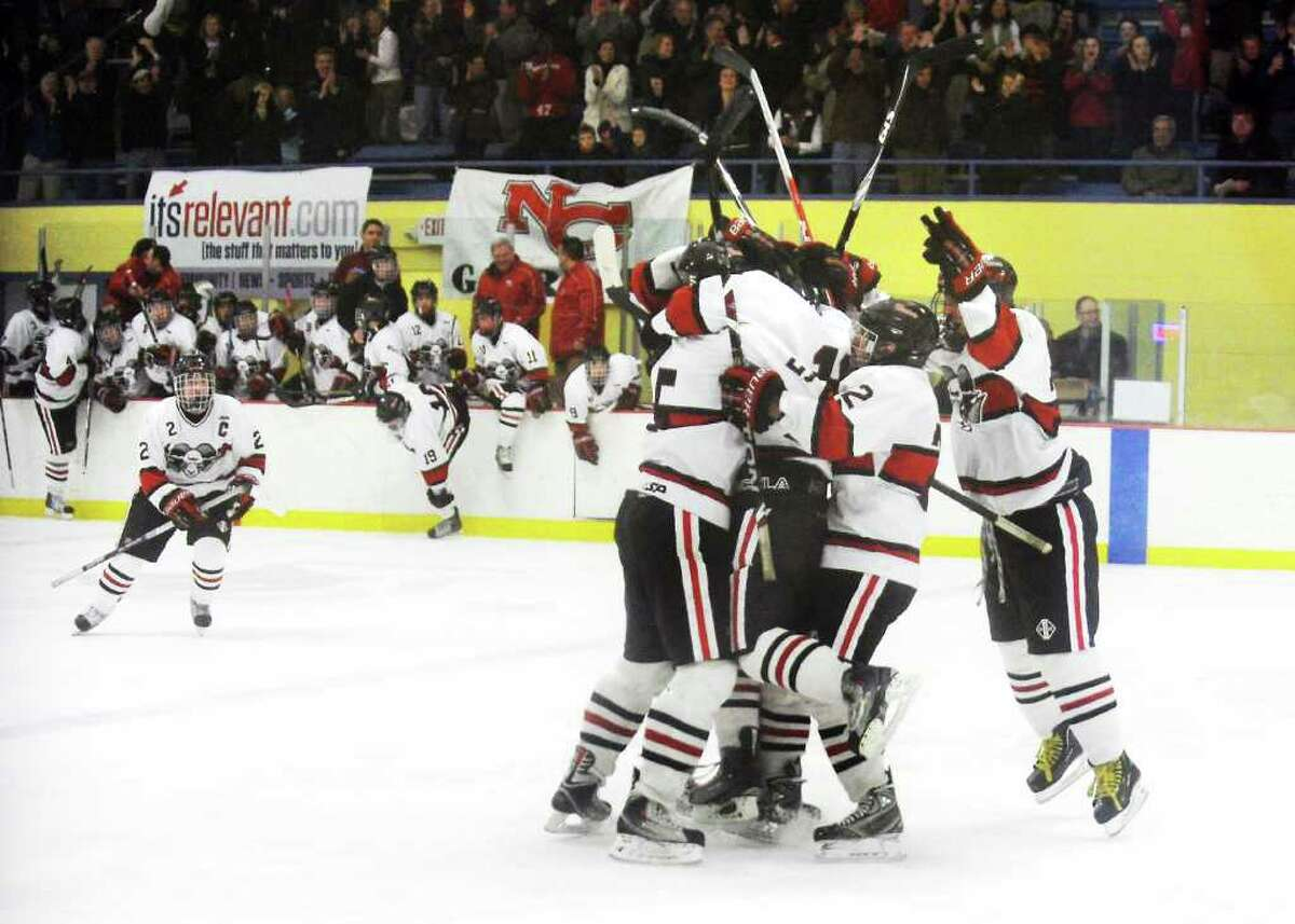 New Canaan celebrates the goal to tie the game 3-3 against St. Joseph in the boys hockey FCIAC championship game at Terry Conners Rink in Stamford, Conn. on Saturday March 5, 2011. New Canaan won 4-3.