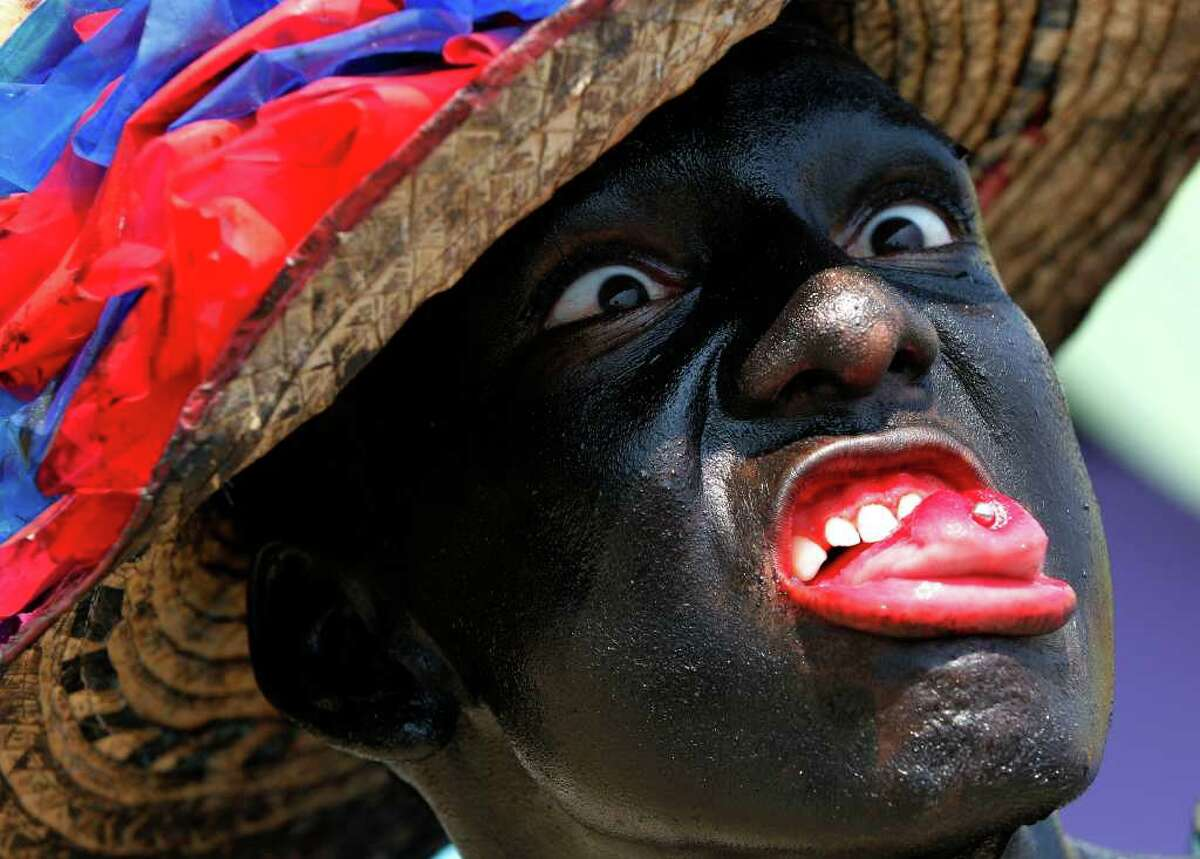 A reveler performs during carnival celebrations in Barranquilla, Colombia, Saturday, March 5, 2011. In 2003 the United Nations Educational, Scientific and Cultural Organization, UNESCO, declared Barranquilla's carnival as a 'Masterpiece of Oral and Intangible Heritage of Humanity'. (AP Photo/ Fernando Vergara)