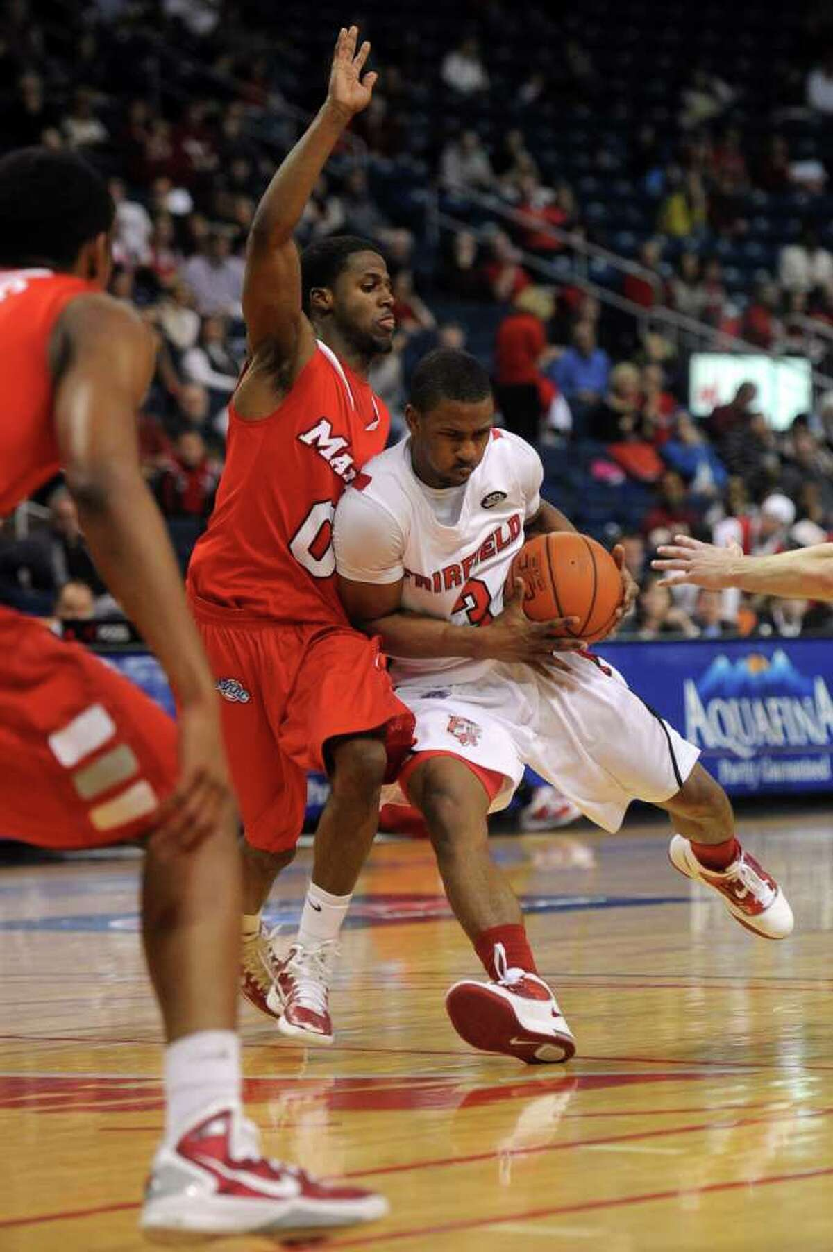 Fairfield University's Derek Needham dribbles as he is guarded by Marist's Devin Price during Saturday's MAAC quarterfinal game at Webster Bank Arena at Harbor Yard on March 5, 2011.