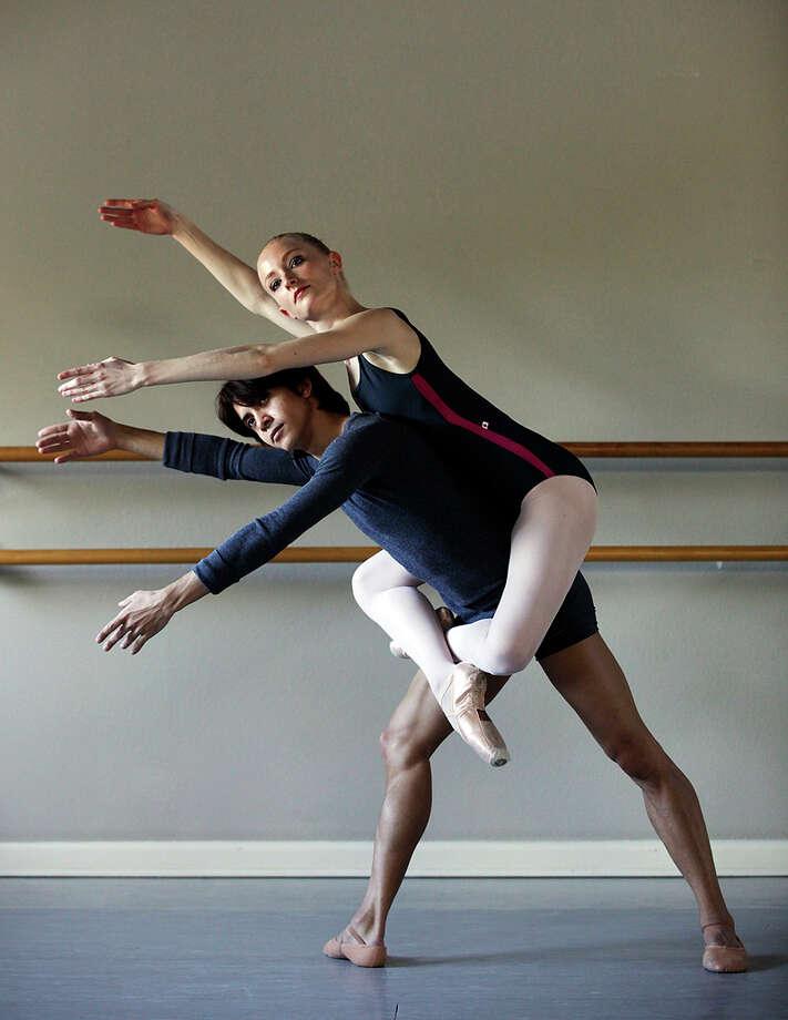 "Ballet San Antonio principal dancers Sarah Aujon and Carlos Hopuy rehearse ""Zenith"" last week. JERRY LARA / EXPRESS-NEWS"